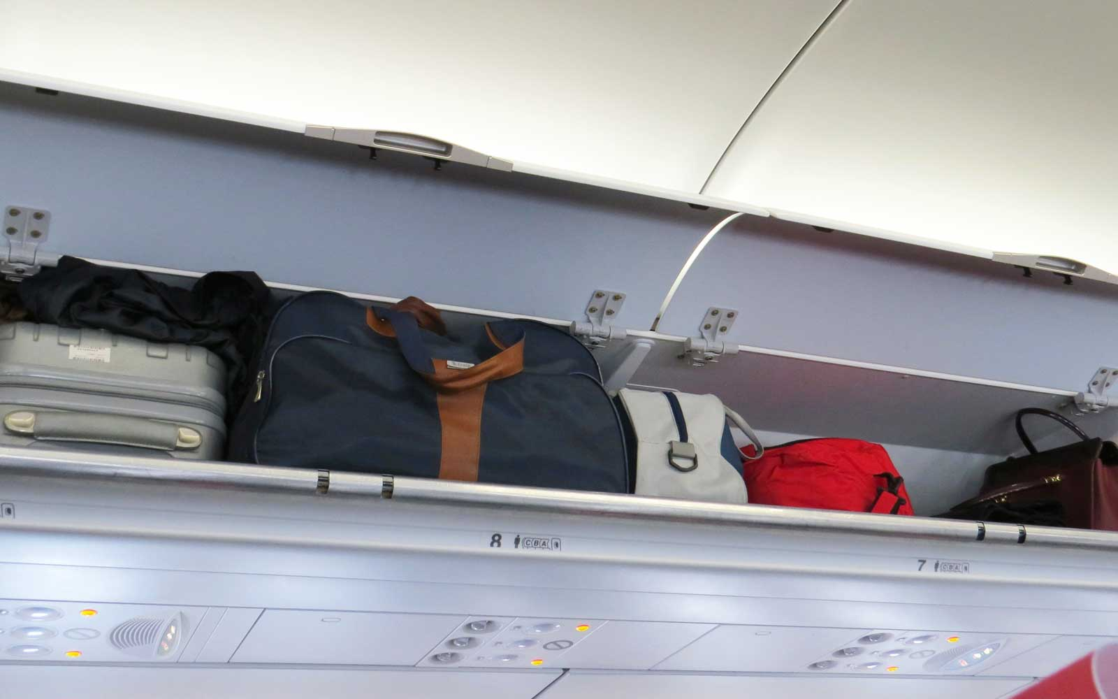 Italy bans overhead luggage lockers, consider it a health risk